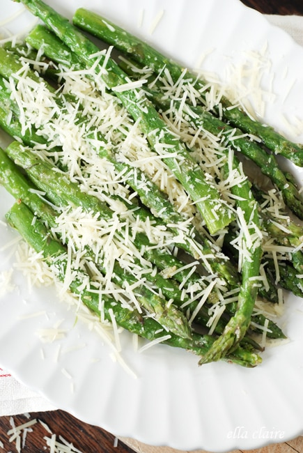 A close up of asparagus with cheese
