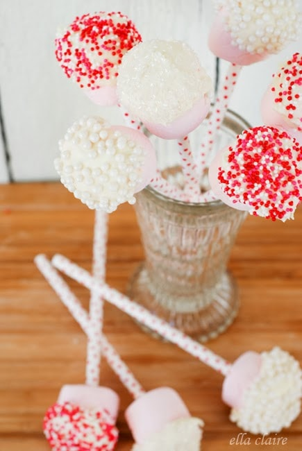 Valentines cake pops in a vase on a table